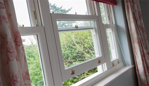 A picture of an open window providing ventilation